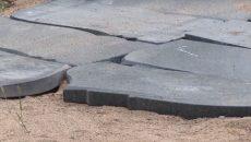 Под Смоленском участок дороги выложили надгробными плитами