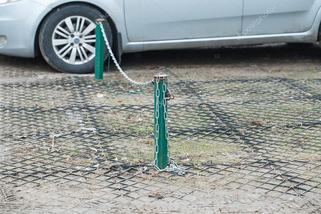 depositphotos_69385097-stock-photo-chain-fence-on-car-parking